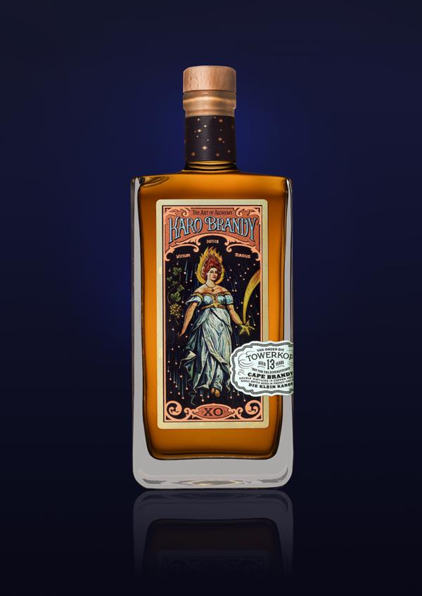 Karo Brandy Golden brown bottle Dark blue Background